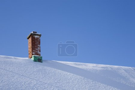 Chimney On A Snowy Roof