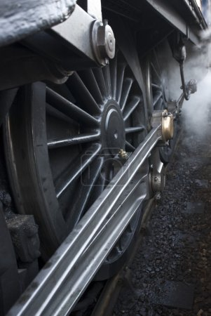 Close-up of steam engine train wheels