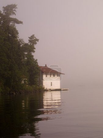 Lake Of The Woods, Ontario, Canada, Cottage Beside A Lake