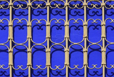 Iron railings against blue walls