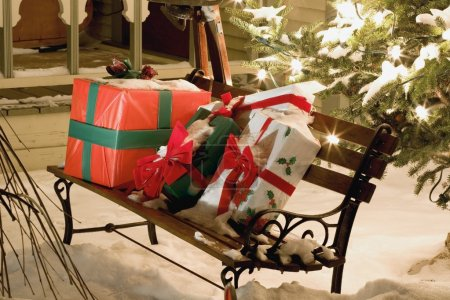 Wrapped Presents Sitting On A Park Bench Outside