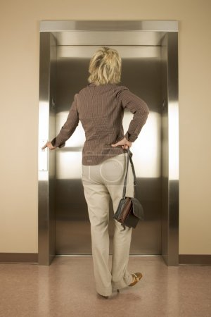 Woman waiting for an elevator