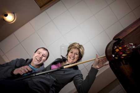 Couple Playing Pool Or Billiards