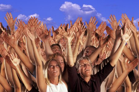Many Hands Raised In Worship