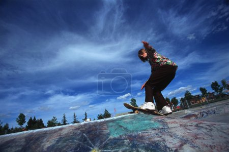 Boarder Performing Stunt At Skate Park