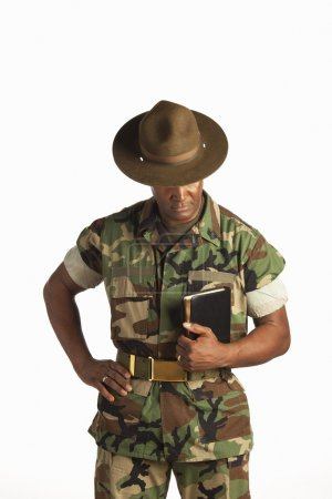 Military Man Holding A Bible