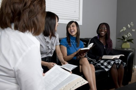 Women Talking And Laughing During A Bible Study