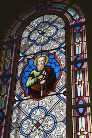 Stained Glass Window Decorated With A Religious Figure