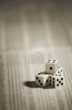Two dices isolated on newspaper