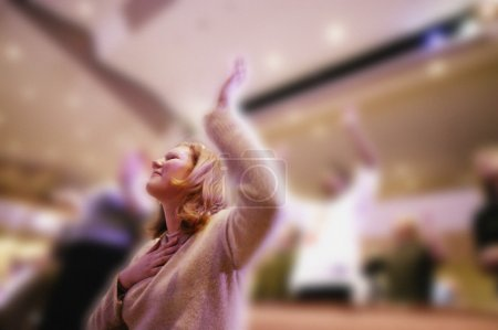 Woman Worshipping In Church