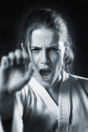 Woman Doing A Karate Punch In Black And White