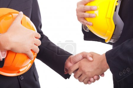 Construction engineers shake hands