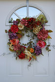 White Door with Flower Wreath