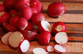 Red globe radishes on a cutting board