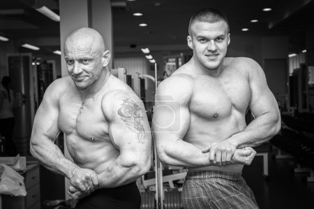 Two bodybuilders demonstrating muscles