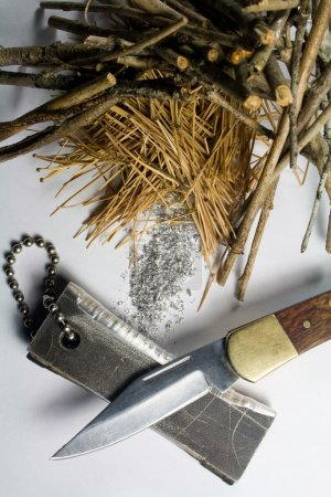 Photo for Magnesium Fire Starter - Magnesium Shavings - Pocket Knife - Tinder Pile - Royalty Free Image