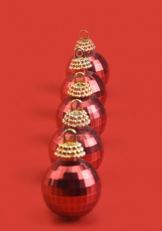 Five red baubles in a row
