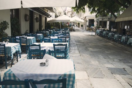 Tables and chairs at a sidewalk cafe