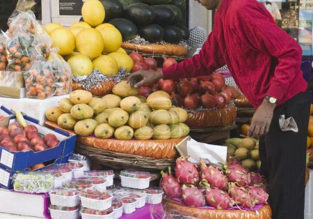 Man choosing fruits at a market stall