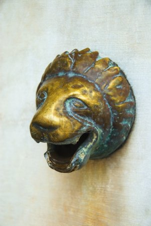 Lion's head shaped water outlet on a wall