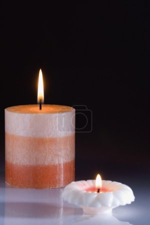 Two colorful candles burning
