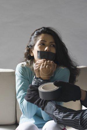 Adhesive tape around woman's hands