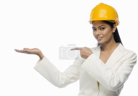 Architect pointing towards her palm