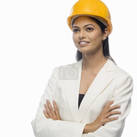 Photo for Female architect smiling with her arms crossed - Royalty Free Image