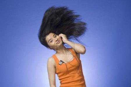Woman listening an MP3 player