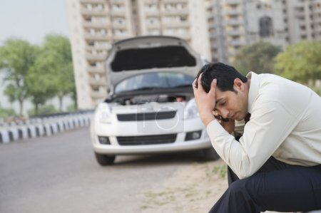 Businessman after his vehicle breakdown