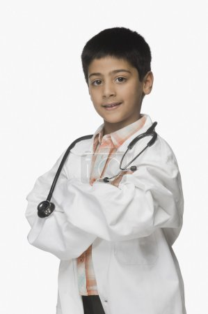Boy wearing lab coat and holding a stethoscope