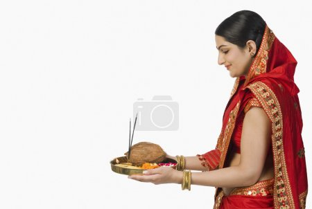 Photo for Woman in red mekhla holding religious offering - Royalty Free Image
