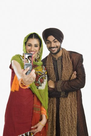 Sikh couple taking a picture of themselves