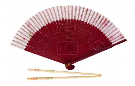 Close-up of a folding fan with chopsticks