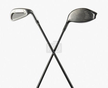Closeup of two golf clubs