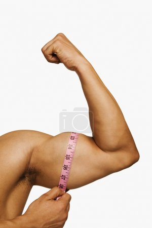 Man measuring his biceps