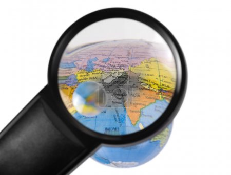 India on globe viewed through a magnifying glass