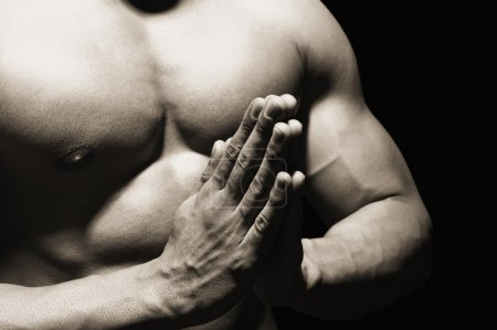 Photo for Mid section view of a muscular man meditating - Royalty Free Image