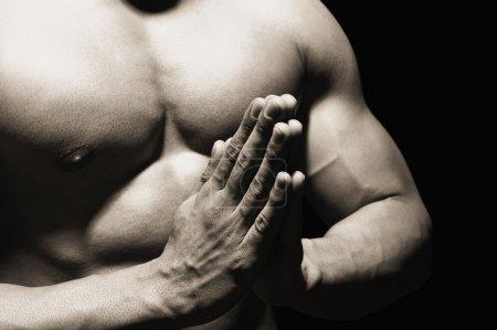 Muscular man meditating