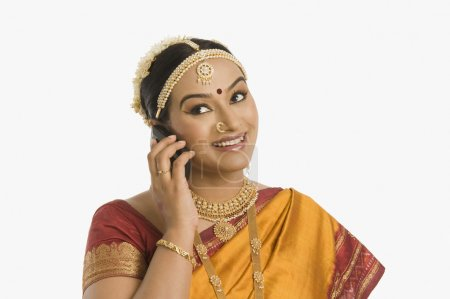 Indian woman talking on mobile phone
