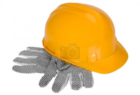 Close-up of protective gloves and a hardhat