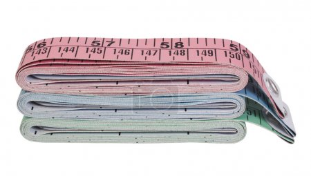 Close-up of a stack of tape measures
