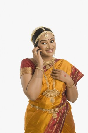 Indian woman talking on a mobile phone