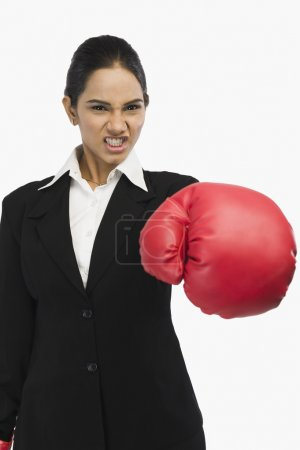 Businesswoman in boxing glove