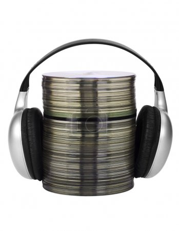 Photo for Stack of compact discs with headphones - Royalty Free Image