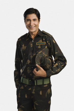 Photo for Portrait of an army soldier smiling - Royalty Free Image