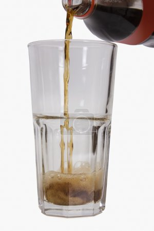 Photo for Close-up of cold drink being poured into a glass - Royalty Free Image
