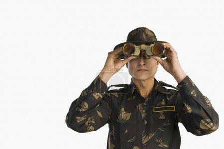 Photo for Army soldier looking through binoculars - Royalty Free Image