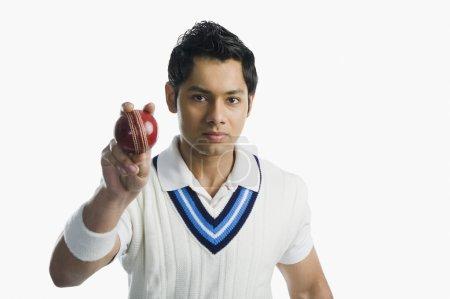 Cricket bowler holding a ball