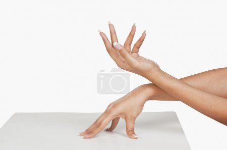 Woman showing her hands after manicure
